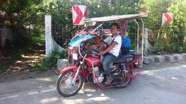 Tricycle zum Hafen